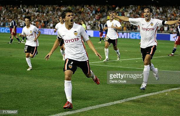 David Villa celebrates after scoring Valencia's second goal against Salzburg during the third qualifying round of the UEFA Champions League match at...