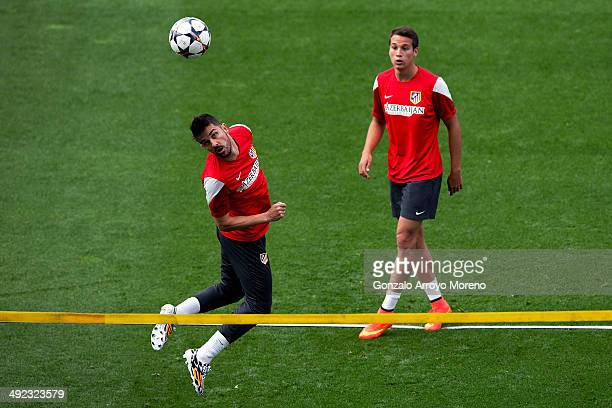 David Villa of Atletico de Madrid and his teammate Javier Manquillo during the training session held on the Media Day prior to UEFA Champions League...