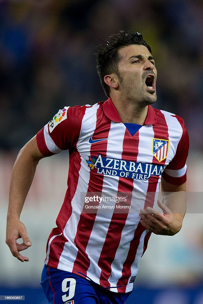 <a gi-track='captionPersonalityLinkClicked' href=/galleries/search?phrase=David+Villa&family=editorial&specificpeople=467566 ng-click='$event.stopPropagation()'>David Villa</a> of Atletico de Madrid celebrates after scoring his team's third goal during the La Liga match between Club Atletico de Madrid and Real Betis Balompieat at Vicente Calderon Stadium on October 27, 2013 in Madrid, Spain.
