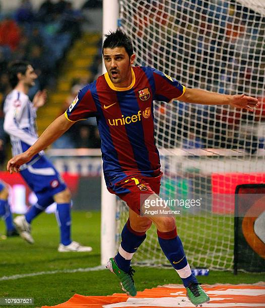 David Villa of Barcelona celebrates after scoring the opening goal of the La Liga match between Deportivo La Coruna and Barcelona at Riazor Stadium...