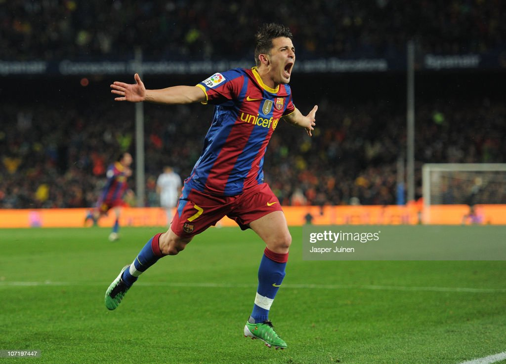David Villa of Barcelona celebrates scoring his sides fourth goal during the la liga match between Barcelona and Real Madrid at the Camp Nou stadium on November 29, 2010 in Barcelona, Spain.