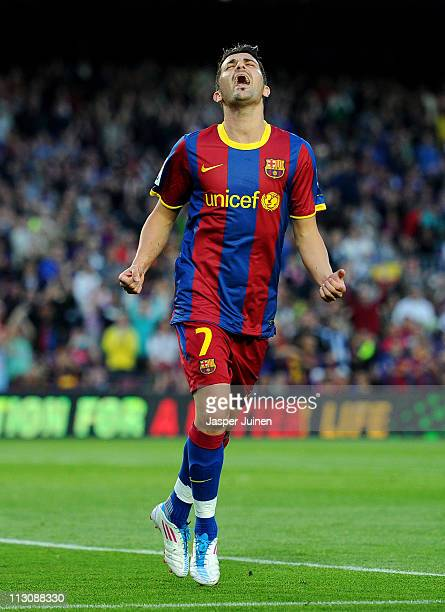 David Villa of Barcelona celebrates scoring his sides opening goal during the la Liga match between Barcelona and Osasuna at the Camp Nou stadium on...