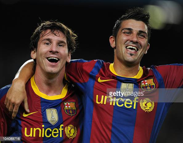 David Villa of Barcelona celebrates scoring his sides second goal with his teammate Lionel Messi during the UEFA Champions League group D match...