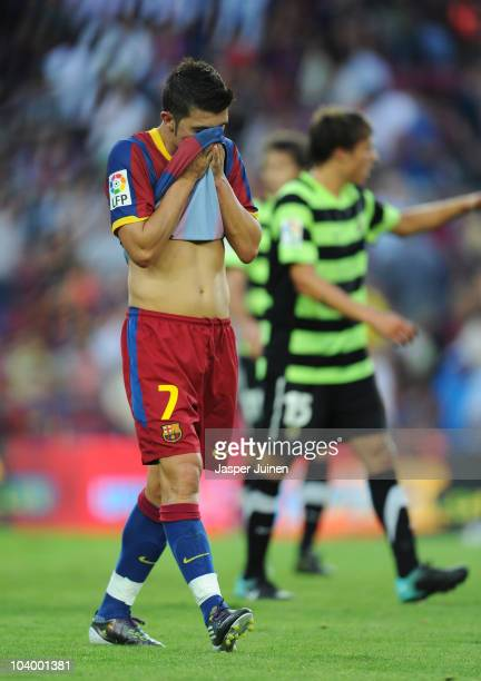 David Villa of Barcelona trudges off the pitch at the end of the La Liga match between Barcelona and Hercules at the Camp Nou stadium on September 11...