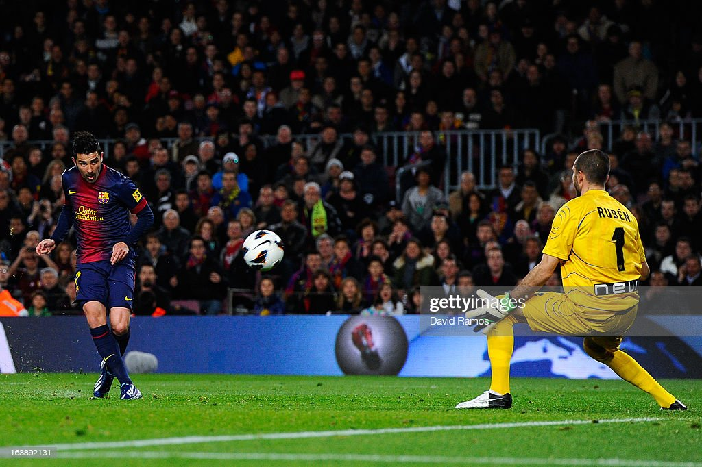 <a gi-track='captionPersonalityLinkClicked' href=/galleries/search?phrase=David+Villa&family=editorial&specificpeople=467566 ng-click='$event.stopPropagation()'>David Villa</a> of FC Barcelona beats Ruben Martinez of Rayo Vallecano scoring the opening goal during the La Liga match between FC Barcelona and Rayo Vallecano at Camp Nou on March 17, 2013 in Barcelona, Spain.