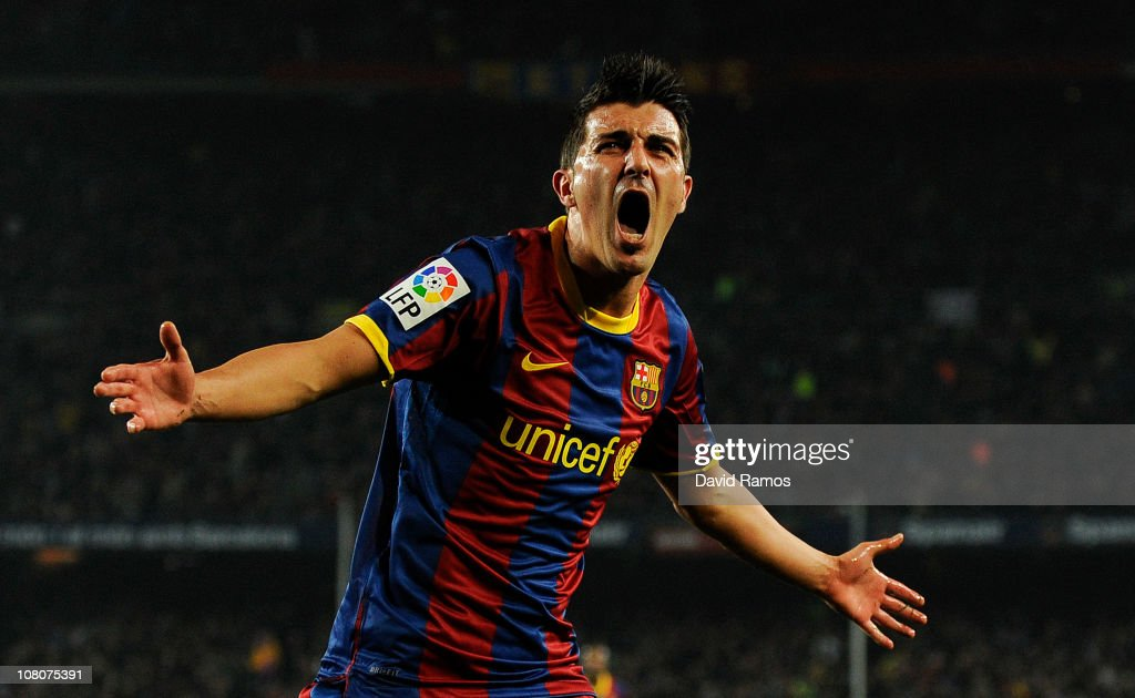 David Villa of FC Barcelona celebrates after scoring his side's second goal during the La Liga match between FC Barcelona and Malaga at Nou Camp on January 16, 2011 in Barcelona, Spain.