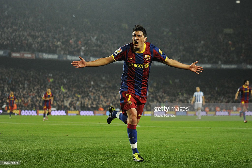 <a gi-track='captionPersonalityLinkClicked' href=/galleries/search?phrase=David+Villa&family=editorial&specificpeople=467566 ng-click='$event.stopPropagation()'>David Villa</a> of FC Barcelona celebrates after scoring his team's second goal during the La Liga match between FC Barcelona and Malaga at Nou Camp on January 16, 2011 in Barcelona, Spain. Barcelona won 4-1.