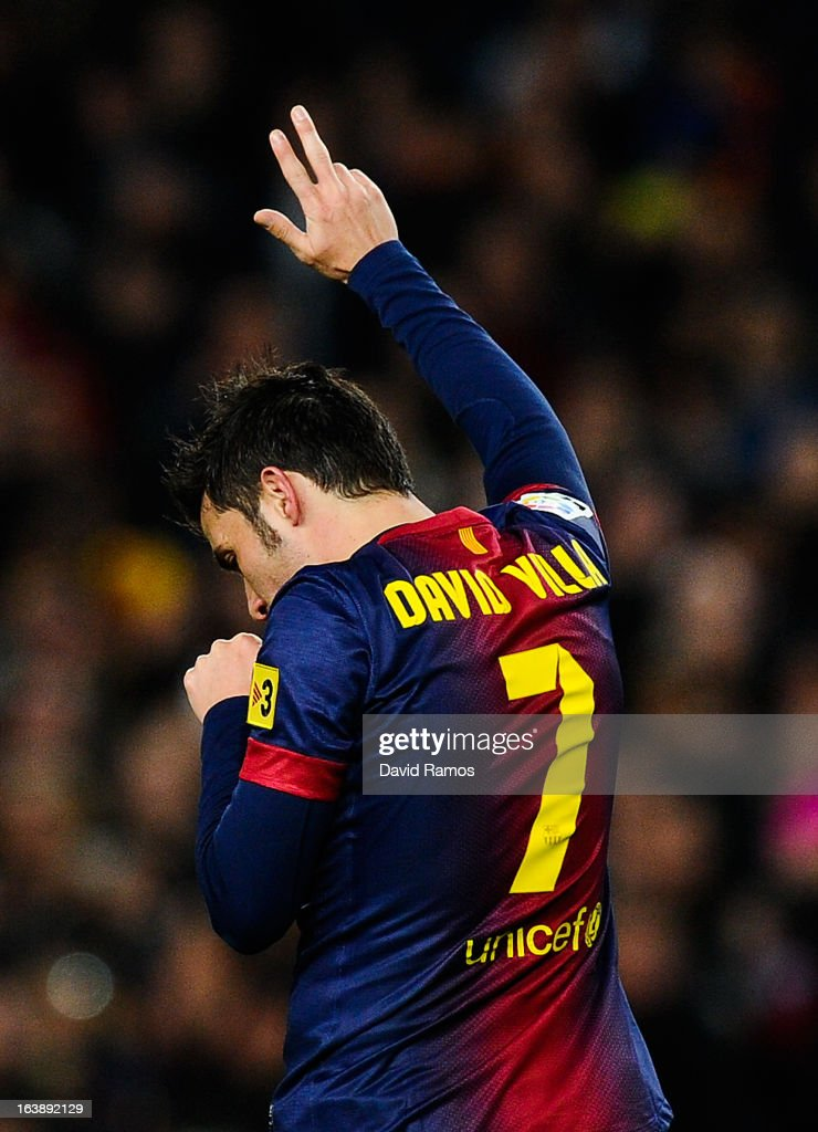 <a gi-track='captionPersonalityLinkClicked' href=/galleries/search?phrase=David+Villa&family=editorial&specificpeople=467566 ng-click='$event.stopPropagation()'>David Villa</a> of FC Barcelona celebrates after scoring the opening goal during the La Liga match between FC Barcelona and Rayo Vallecano at Camp Nou on March 17, 2013 in Barcelona, Spain.
