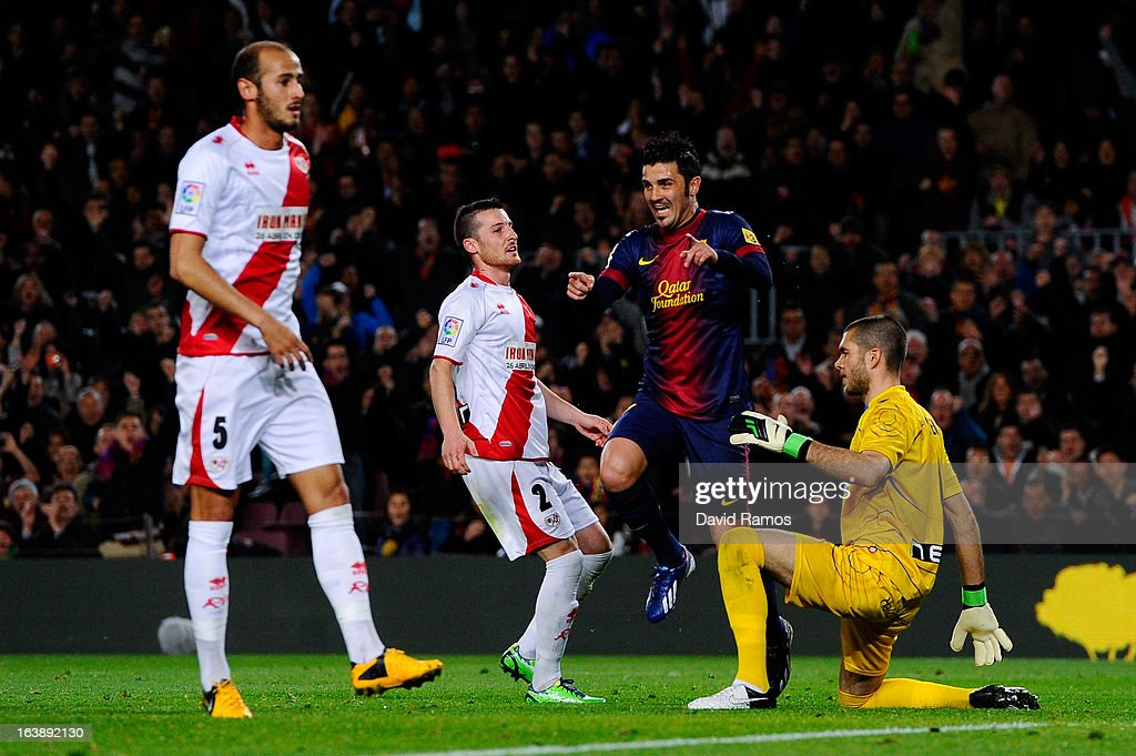 <a gi-track='captionPersonalityLinkClicked' href=/galleries/search?phrase=David+Villa&family=editorial&specificpeople=467566 ng-click='$event.stopPropagation()'>David Villa</a> of FC Barcelona (2ndR) celebrates among Roberto Roman 'Tito' and Roberto Roman 'Tito' of Rayo Vallecano after scoring the opening goal during the La Liga match between FC Barcelona and Rayo Vallecano at Camp Nou on March 17, 2013 in Barcelona, Spain.