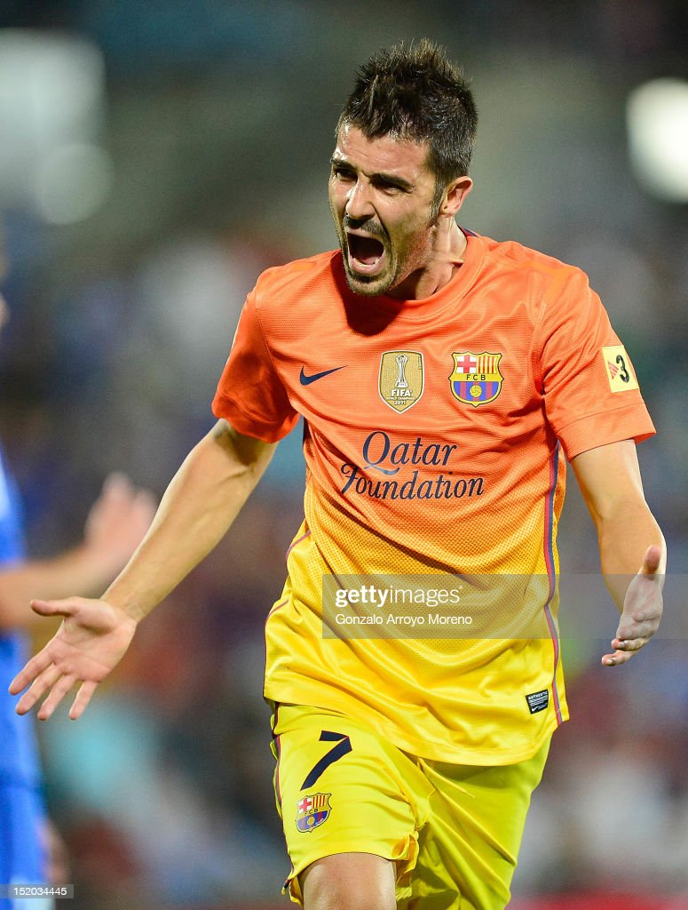 David Villa of FC Barcelona celebrates scoring their fourth goal during the La Liga match between Getafe CF and FC Barcelona at Coliseum Alfonso...