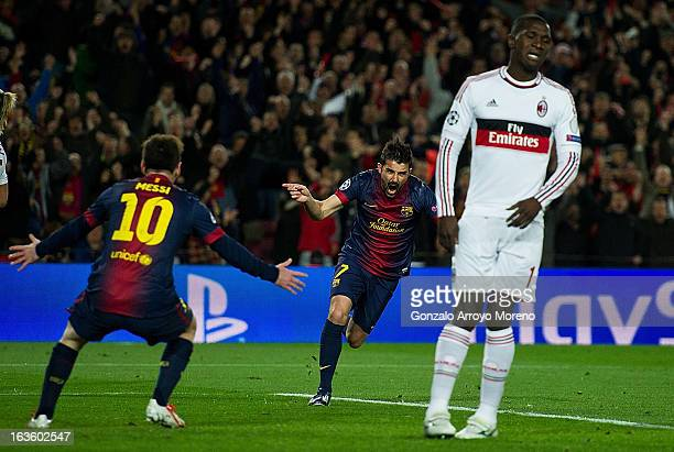 David Villa of FC Barcelona celebrates scoring their third goal with teammate Lionel Messi while Cristian Zapata of AC Milan reacts defeated during...