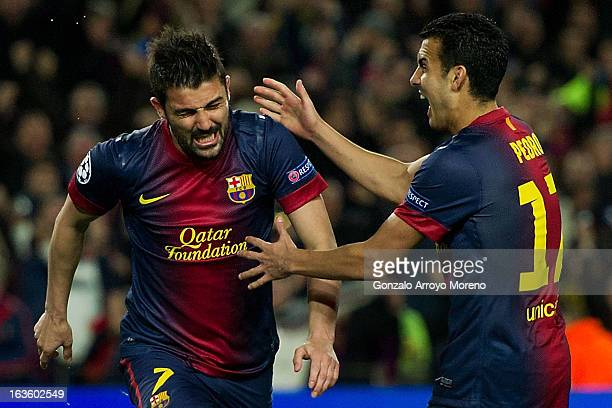 David Villa of FC Barcelona celebrates scoring their third goal with teammate Pedro Rodriguez Ledesma during the UEFA Champions League Round of 16...