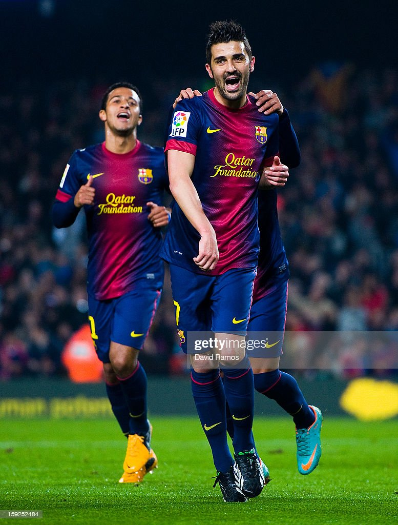 David Villa of FC Barcelona celebrates with his team-mates after scoring their second goal during the Copa del Rey round of sixteen second leg match between FC Barcelona and Cordoba CF at Camp Nou on January 10, 2013 in Barcelona, Spain.