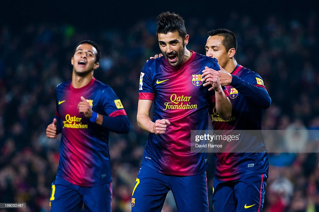 <a gi-track='captionPersonalityLinkClicked' href=/galleries/search?phrase=David+Villa&family=editorial&specificpeople=467566 ng-click='$event.stopPropagation()'>David Villa</a> of FC Barcelona celebrates with his team-mates after scoring their second goal during the Copa del Rey round of sixteen second leg match between FC Barcelona and Cordoba CF at Camp Nou on January 10, 2013 in Barcelona, Spain.