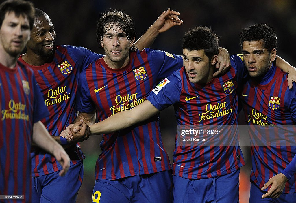 David Villa of FC Barcelona (2ndR) celebrates with his teammates (L-R) Lionel Messi, Seydou Keita, Maxwell Scherrer and Dani Alves of FC Barcelona after scoring his fourth team's goal during the la Liga Match between FC Barcelona and Real Zaragoza at Camp Nou on November 19, 2011 in Barcelona, Spain.