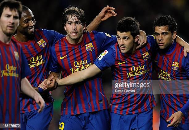 David Villa of FC Barcelona celebrates with his teammates Lionel Messi Seydou Keita Maxwell Scherrer and Dani Alves of FC Barcelona after scoring his...
