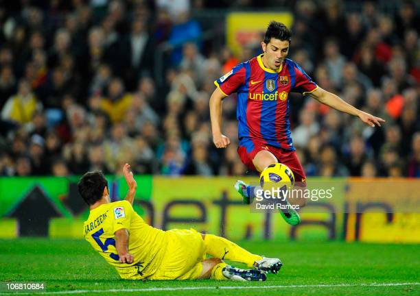 David Villa of FC Barcelona duels for the ball to score against Carlos Marchena of Villarreal CF duel for the ball during the La Liga match between...