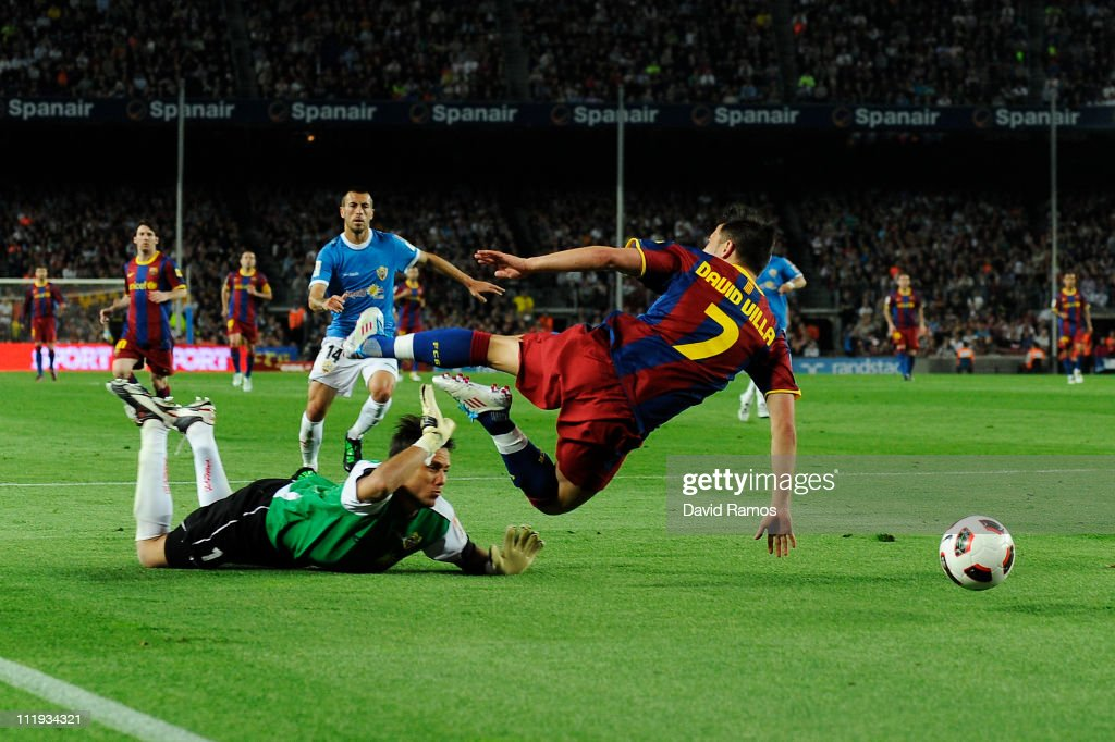 David Villa of FC Barcelona (R) is brought down by Diego Alves of Almeria to win a penalty during the La Liga match between FC Barcelona and UD Almeria at Camp Nou on April 9, 2011 in Barcelona, Spain.