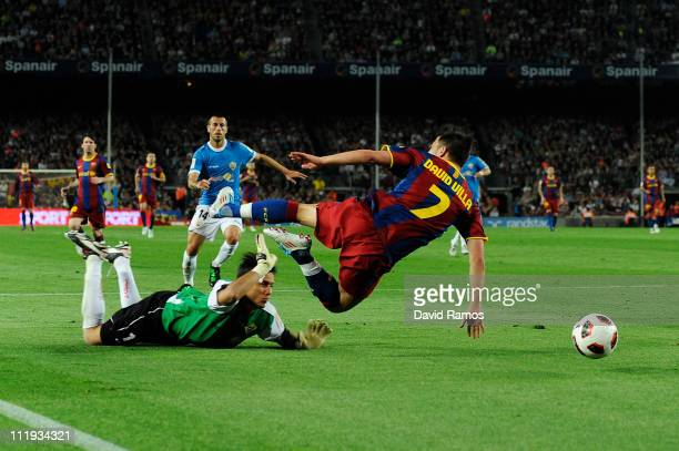 David Villa of FC Barcelona is brought down by Diego Alves of Almeria to win a penalty during the La Liga match between FC Barcelona and UD Almeria...