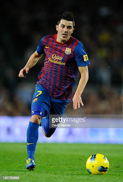 David Villa of FC Barcelona runs with the ball during the La Lliga match between FC Barcelona and RCD mallorca at Camp Nou on October 29 2011 in...