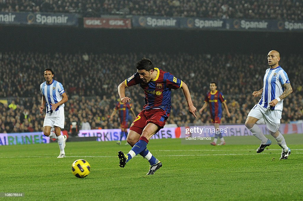 <a gi-track='captionPersonalityLinkClicked' href=/galleries/search?phrase=David+Villa&family=editorial&specificpeople=467566 ng-click='$event.stopPropagation()'>David Villa</a> of FC Barcelona (C) scores his first side's goal during the La Liga match between FC Barcelona and Malaga at Nou Camp on January 16, 2011 in Barcelona, Spain. Barcelona won 4-1.