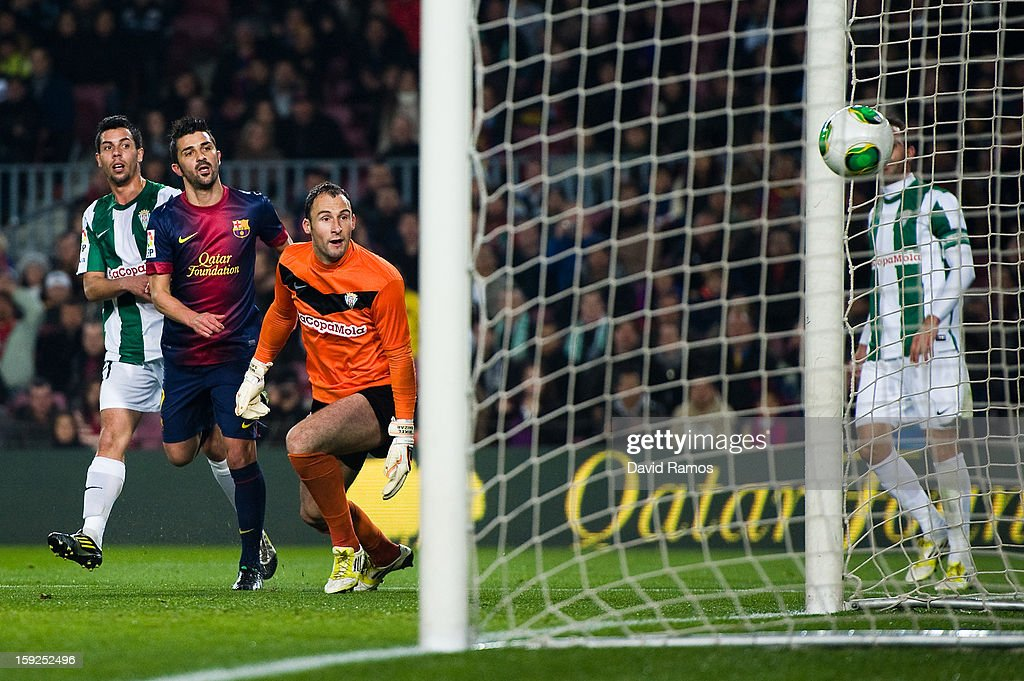 <a gi-track='captionPersonalityLinkClicked' href=/galleries/search?phrase=David+Villa&family=editorial&specificpeople=467566 ng-click='$event.stopPropagation()'>David Villa</a> of FC Barcelona (2ndL) scores his team's second goal during the Copa del Rey round of sixteen second leg match between FC Barcelona and Cordoba CF at Camp Nou on January 10, 2013 in Barcelona, Spain.