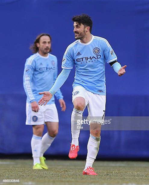 David Villa of New York City FC argues after a play in the first half against the New England Revolution during the inaugural game of the New York...