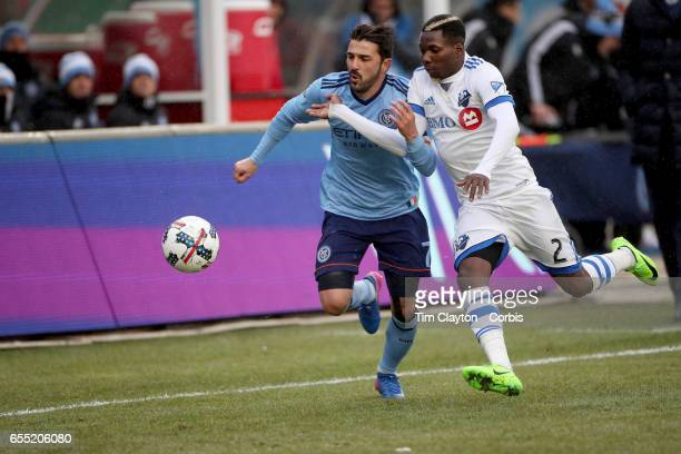 David Villa of New York City FC challenges Ambroise Oyongo of Montreal Impact during the New York City FC Vs Montreal Impact regular season MLS game...