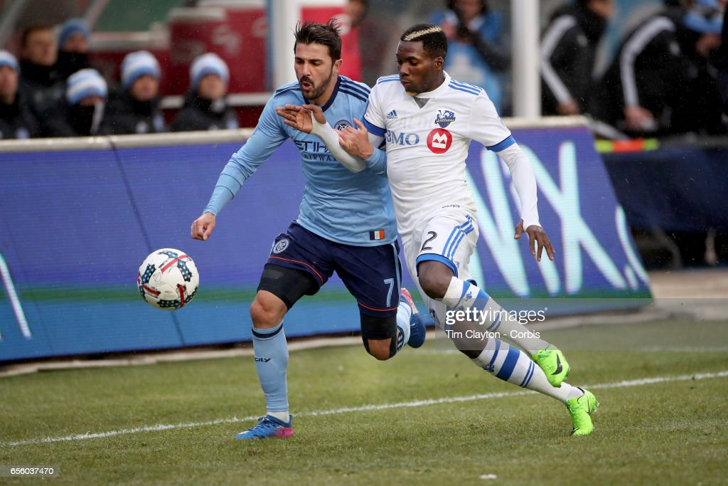 David Villa #7 of New York City FC challenges Ambroise Oyongo #2 of Montreal Impact during the New York City FC Vs Montreal Impact regular season MLS game at Yankee Stadium on March 18, 2017 in New York City.