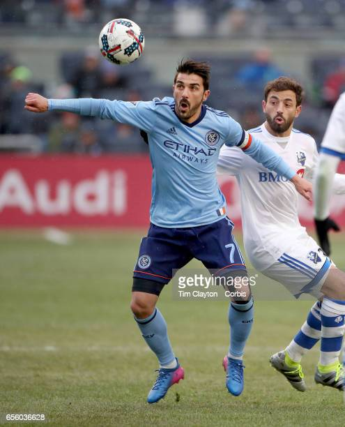 David Villa of New York City FC is challenged by Hernan Bernardello of Montreal Impact during the New York City FC Vs Montreal Impact regular season...