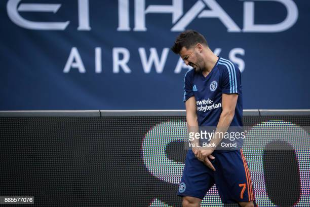 David Villa of New York City FC shows the pain of a hand injury during warm ups prior to the MLS match between New York City FC and Columbus Crew at...