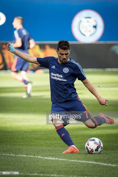 David Villa of New York City FC takes a shot on goal during warm ups prior to the MLS match between New York City FC and Columbus Crew at Citi Field...