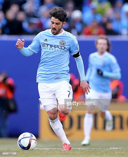 David Villa of New York City FC takes the ball in the first half against the New England Revolution during the inaugural game of the New York City FC...