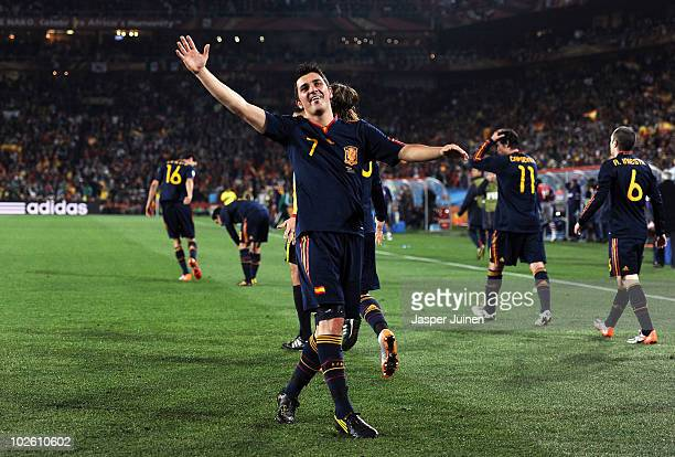David Villa of Spain celebrates after he scores his side's first goal during the 2010 FIFA World Cup South Africa Quarter Final match between...