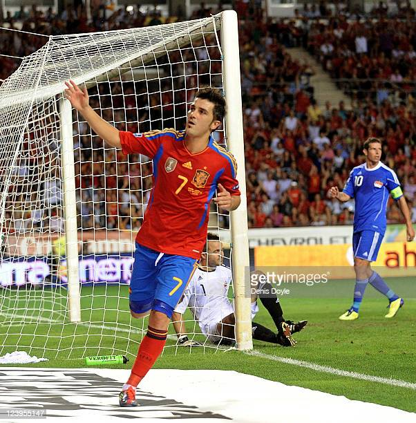 David Villa of Spain celebrates after scoring Spain's sixth goal during the EURO 2012 Qualifier match between Spain and Liechtenstein at estadio Las...