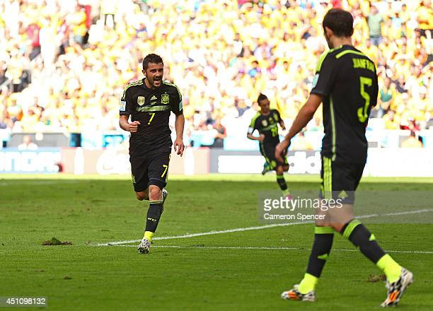 David Villa of Spain celebrates scoring his team's first goal with Juanfran during the 2014 FIFA World Cup Brazil Group B match between Australia and...