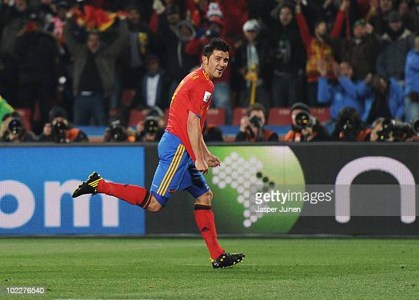 David Villa of Spain celebrates scoring the opening goal during the 2010 FIFA World Cup South Africa Group H match between Spain and Honduras at...