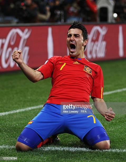 David Villa of Spain celebrates scoring the opening goal during the 2010 FIFA World Cup South Africa Round of Sixteen match between Spain and...
