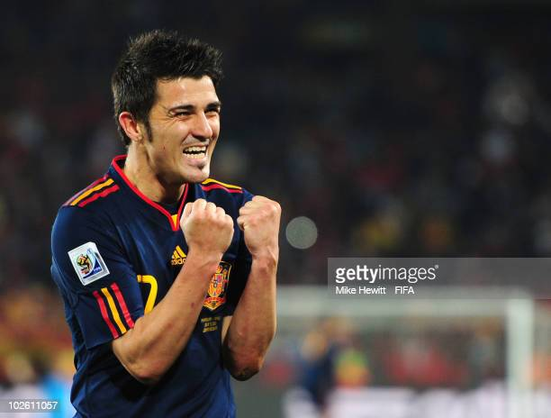 David Villa of Spain celebrates victory and a place in the semifinals following the 2010 FIFA World Cup South Africa Quarter Final match between...