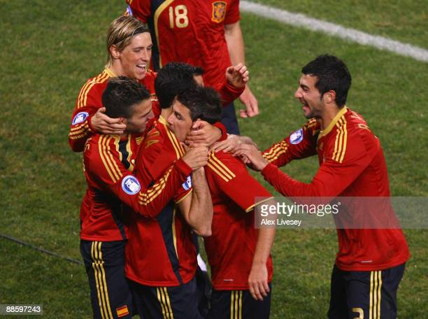 David Villa of Spain celebrates with his team mates after scoring the opening goal during the FIFA Confederations Cup match between Spain and South...