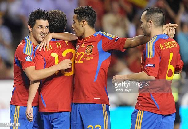 David Villa of Spain celebrates with Juan Mata Thiago Alcantara and Andres Iniesta after scoring Spain's 3rd goal during the EURO 2012 Qualifier...
