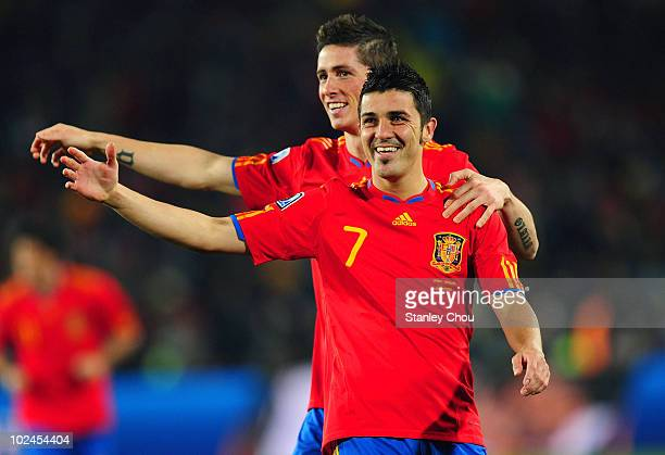 David Villa of Spain celebrates with team mate Fernando Torres during the 2010 FIFA World Cup South Africa Group H match between Spain and Honduras...