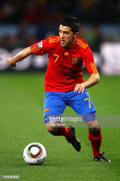 David Villa of Spain runs with the ball during the 2010 FIFA World Cup South Africa Round of Sixteen match between Spain and Portugal at Green Point...