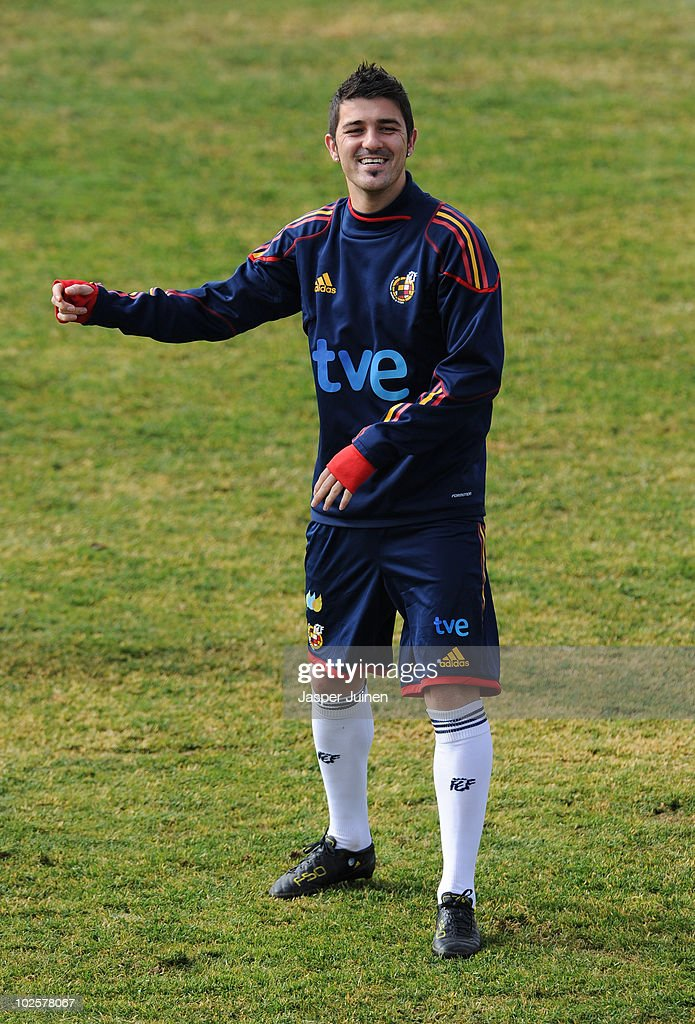 <a gi-track='captionPersonalityLinkClicked' href=/galleries/search?phrase=David+Villa&family=editorial&specificpeople=467566 ng-click='$event.stopPropagation()'>David Villa</a> of Spain smiles during a training session, ahead of their World Cup 2010 Quarter-Final match against Paraguay, on July 2, 2010 in Potchefstroom, South Africa.