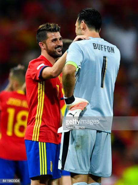 David Villa of Spain talks with Gianluigi Buffon of Italy at the end of the FIFA 2018 World Cup Qualifier between Spain and Italy at Estadio Santiago...