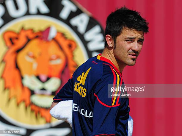 David Villa of Spain walks back to the team hotel after a training session ahead of their World Cup 2010 QuarterFinal match against Paraguay on July...