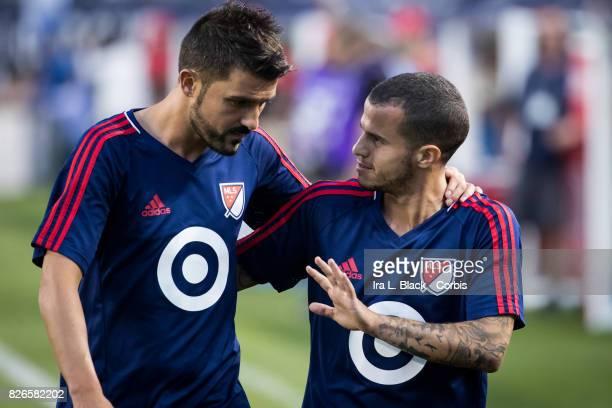 David Villa of the MLS AllStar team and Sebastian Giovinco of the MLS AllStars share a moment during the MLS AllStar match between the MLS AllStars...