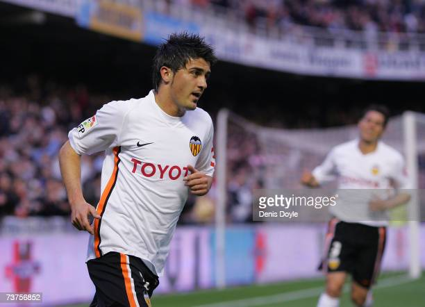 David Villa of Valencia celebrates after scoring Valencia's first goal in the Primera Liga match between Valencia and Espanol at the Mestalla stadium...