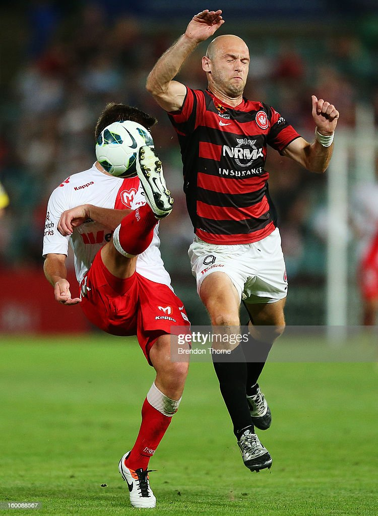 David Vrankovic of the Heart competes with Dino Kresinger of the Wanderers during the round 18 A-League match between the Western Sydney Wanderers and the Melbourne Heart at Parramatta Stadium on January 26, 2013 in Sydney, Australia.