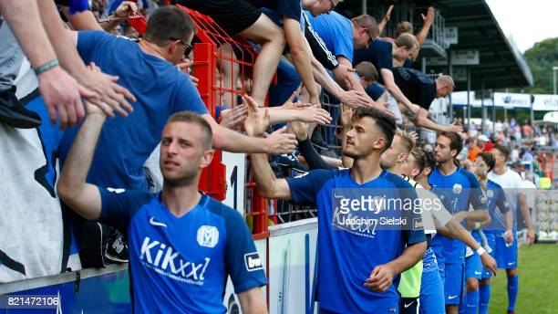 David Vrzogic and Haris Hyseni with the Fans of Meppen after the 3 Liga match between SV Meppen and FC Wuerzburger Kickers at Haensch Arena on July...